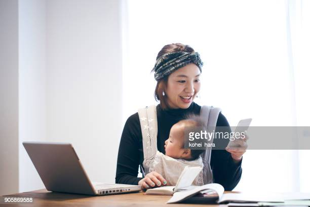 mother with baby working at home - homemaker stock pictures, royalty-free photos & images