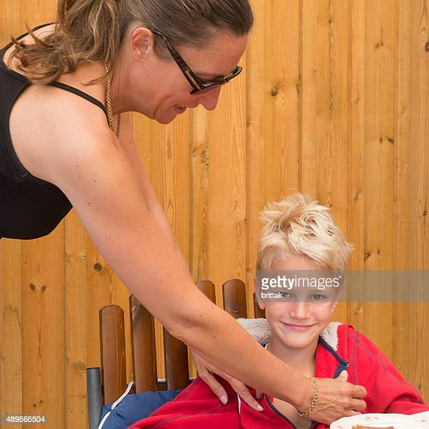 mother with blond seven years old son with wide smile. - 6 7 years stock pictures, royalty-free photos & images