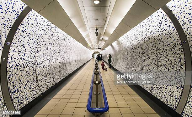 mother with child in green park tube station - station stock pictures, royalty-free photos & images