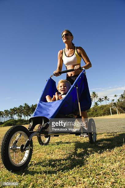 mother with child in stroller - thinkstock foto e immagini stock
