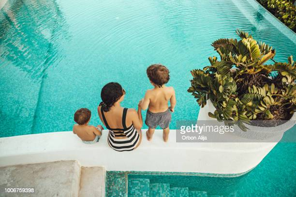 mother with children at the pool - tourist resort stock pictures, royalty-free photos & images