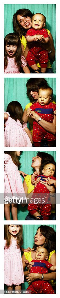 Mother with children (1-3) in photo booth : Bildbanksbilder