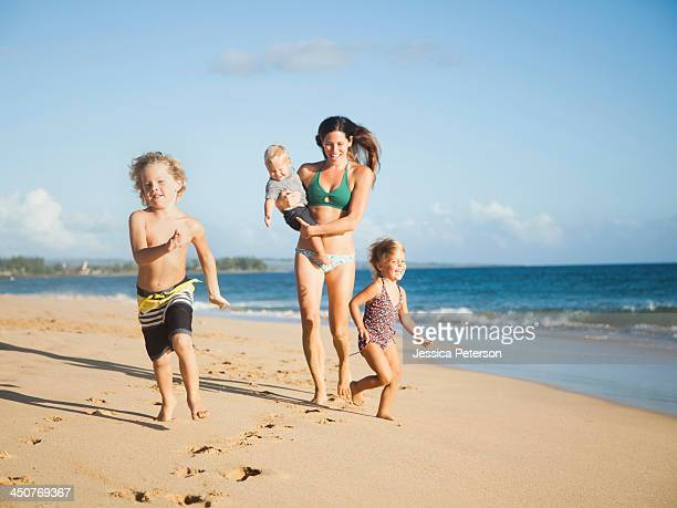 Mother with children on beach