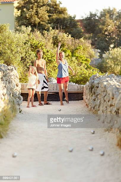 Mother with children playing boules
