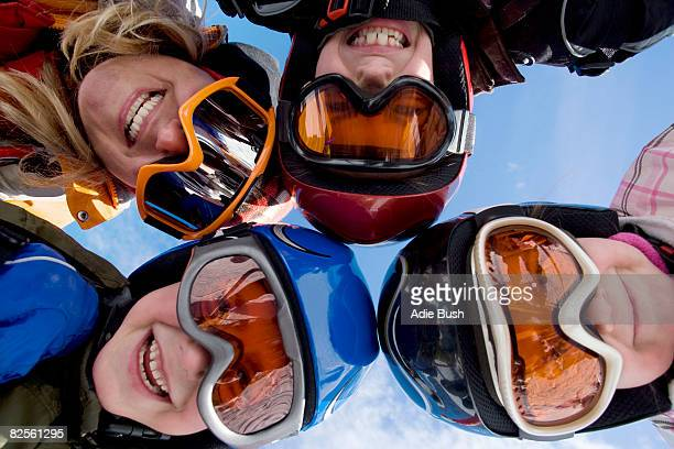 Mother with children wearing ski helmets