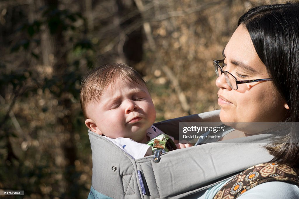 e809a89375a Mother With Cute Baby Boy In Sling   Stock Photo