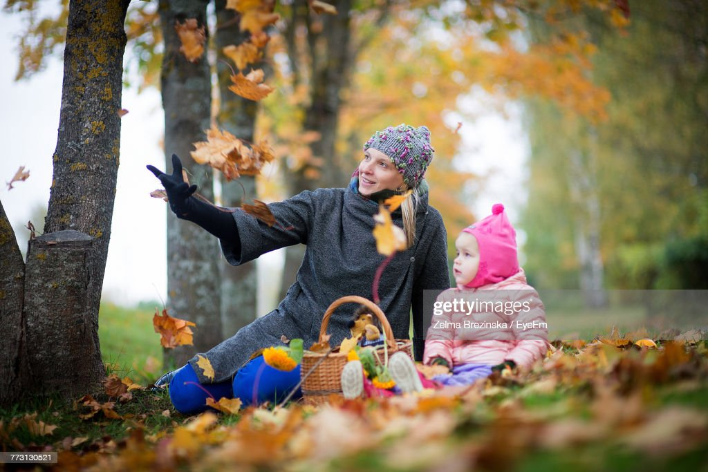 Mother With Cute Baby Girl At Park During Autumn : Photo