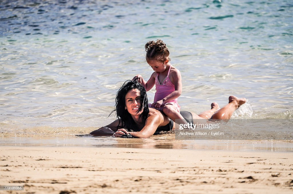 Mother With Daughter Enjoying At Beach : Foto de stock