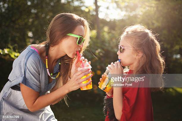 Mother with daughter enjoying bubble tea