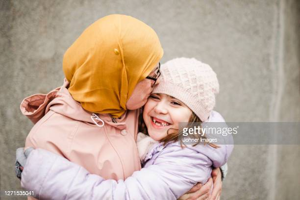 mother with daughter hugging - västra götaland county stock pictures, royalty-free photos & images