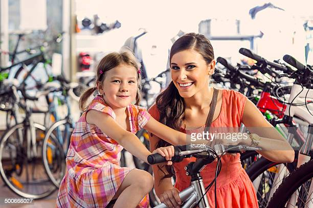 Mother with daughter in bike store