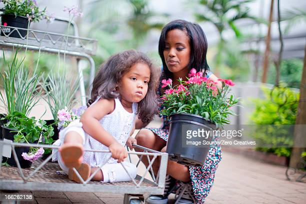 Mother with daughter in cart at nursery