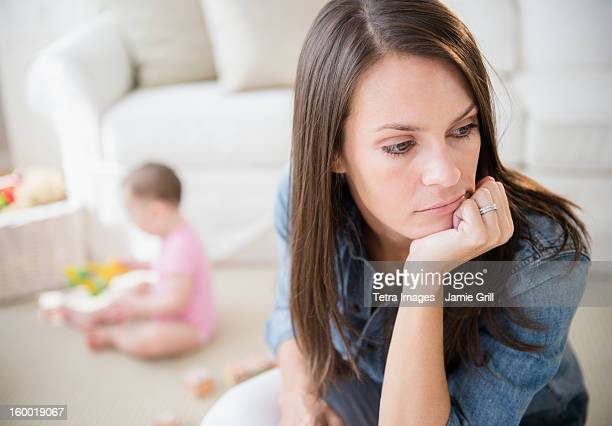 mother with daughter (6-11 months) in living room - postpartum depression stock photos and pictures