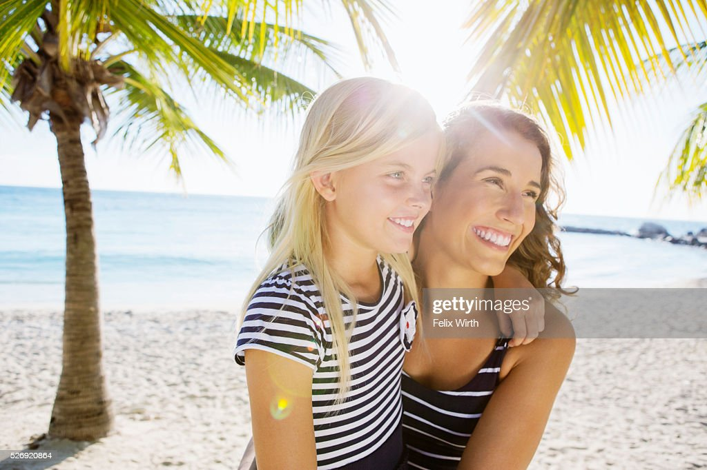 Mother with daughter (10-11) laughing on beach : Photo
