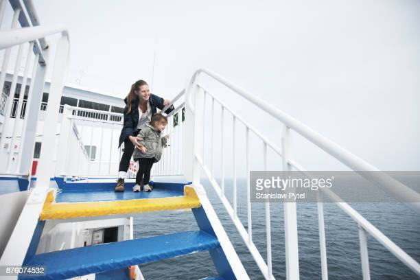 mother with daughter looking at ocean from ferry - ferry stock photos and pictures