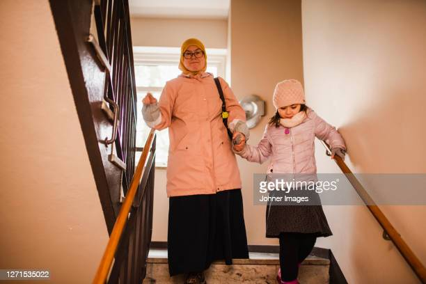 mother with daughter on staircase - västra götaland county stock pictures, royalty-free photos & images