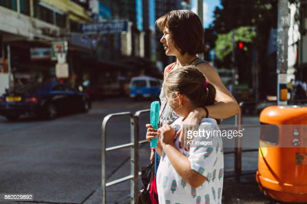 mother with daughter on the street - southern european descent stock pictures, royalty-free photos & images