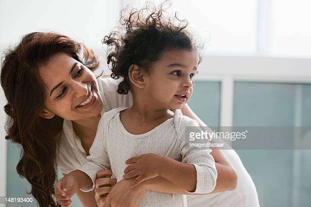 mother with daughter (2-3) - indian subcontinent ethnicity stock pictures, royalty-free photos & images