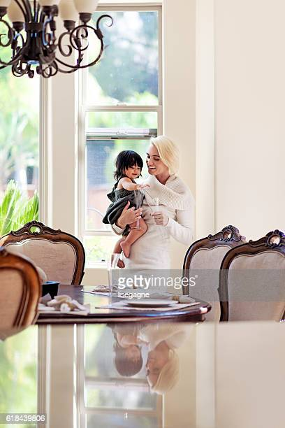 mother with daughter set the table - stepfamily stock photos and pictures