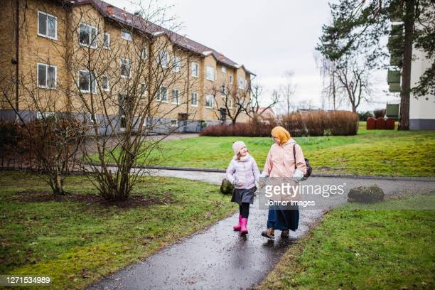 mother with daughter walking together - västra götaland county stock pictures, royalty-free photos & images