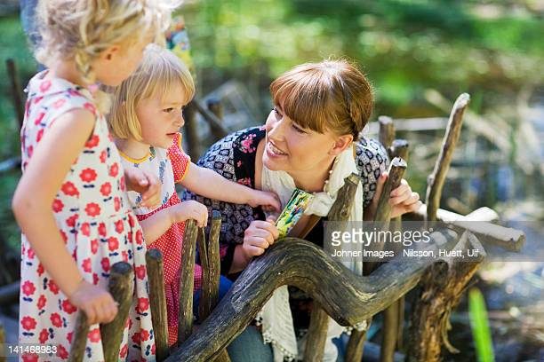 mother with daughters at zoo - zoo stock pictures, royalty-free photos & images