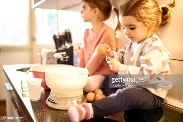Mother with daughters in the kitchen