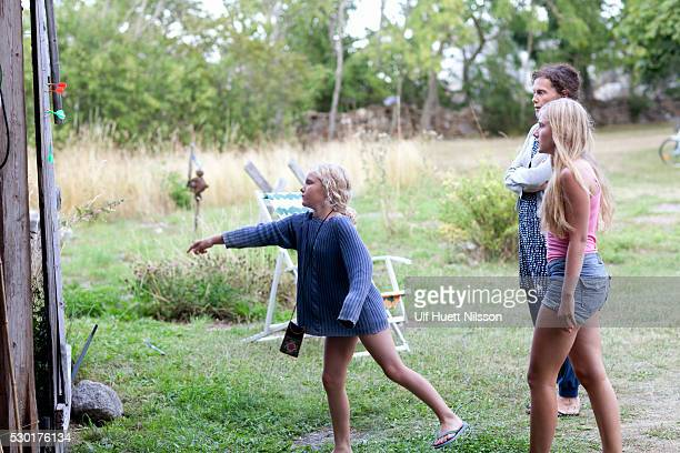 Mother with daughters playing darts