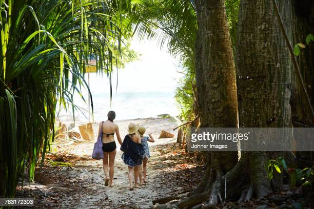 Mother with daughters walking at beach