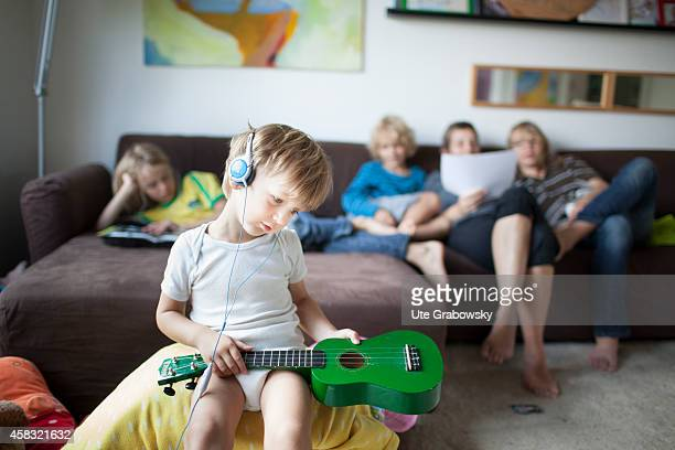Mother with four sons at age of three six eight and twelve in the living room on August 05 in Sankt Augustin Germany Photo by Ute Grabowsky/Photothek...