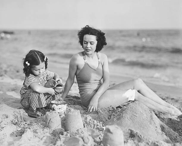 Mother With Girl (2-3) Playing In Sand On Beach, (B&W) Wall Art