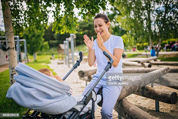Mother with her child in stroller