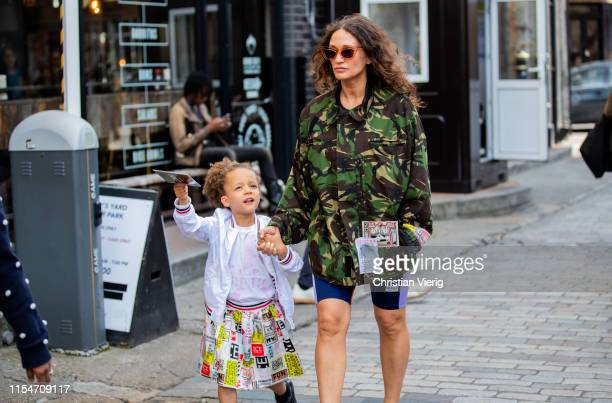 A mother with her child is seen outside Iceberg during London Fashion Week Men's June 2019 on June 08 2019 in London England