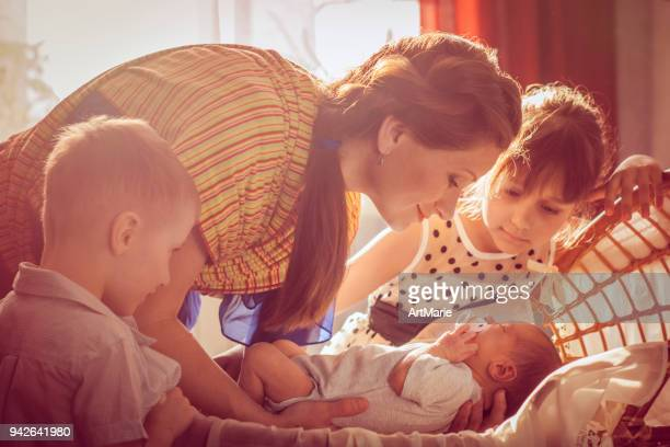 Mother with her children and newborn baby