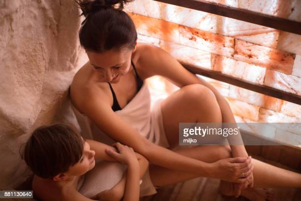 mother with her children in spa center - himalayan salt stock pictures, royalty-free photos & images