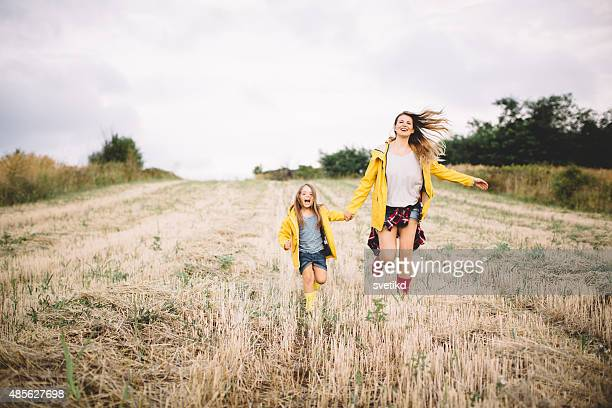 Mother with her cute daughter in meadow.