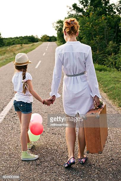 Mother with her cute daughter traveling