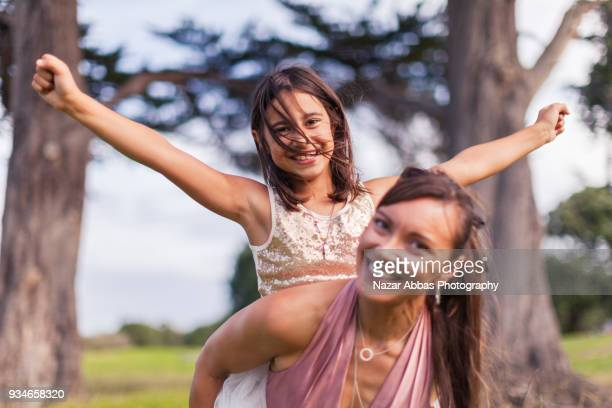 Mother with her daughter enjoying outdoors.