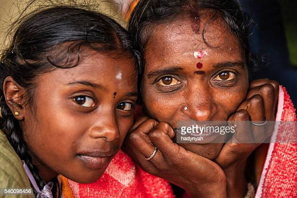 Mother with her daughter keep each other warm, Ceylon