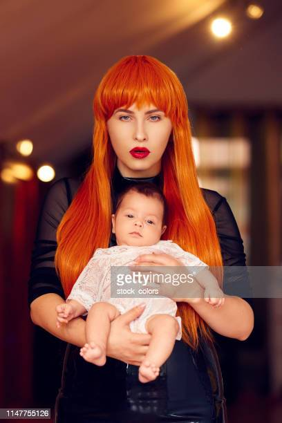 mother with her daughter - black ginger baby stock photos and pictures