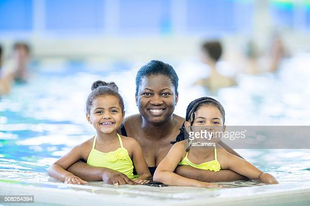 Mother with Her Daughters at the Pool