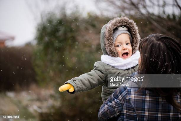 Mother with her girl child outdoors in winter