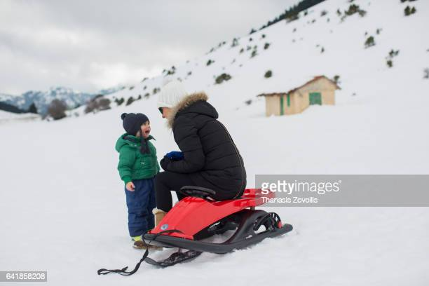 Mother with her kid enjoy snow