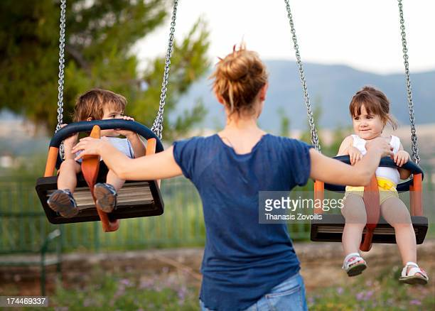 Mother with her kids in a playground
