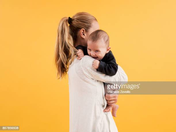 mother with her newborn son - dansstudio stock pictures, royalty-free photos & images