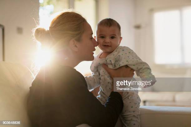 mother with her newborn son - morning stock pictures, royalty-free photos & images