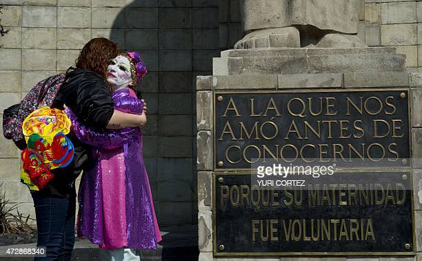 A mother with her painted face is comforted while participating in a protest during the Mother's Day commemoration in Mexico City on May 10 2015...