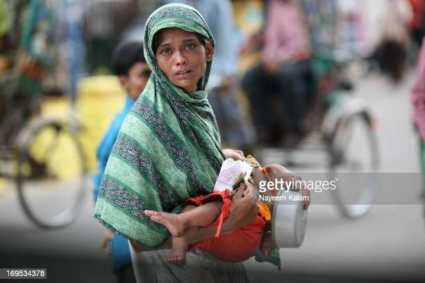 Mother with her sick son, looks for help. She begged everybody but such is the tragedy, due to other beggars' lies nobody believes her. She even has...