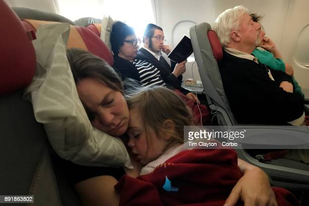 A mother with her sleeping three year old daughter on a flight from New York to Rome Italy 22nd October 2017 Photo by Tim Clayton/Corbis via Getty...