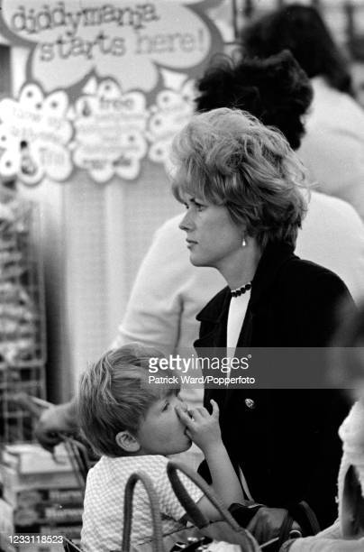Mother with her small boy in a supermarket queue in West London, circa July 1969. From a series of images to illustrate the many frustrations of...