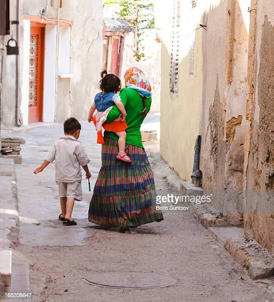 CONTENT] Mother with her son and daughter walking along deserted streets of Kyrenia in Northern Nicosia the territory which is controlled by Turkey...